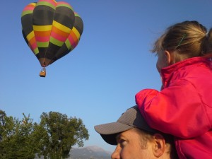 Chelsea,  a glimpse of life...riding on Daddy's shoulders!