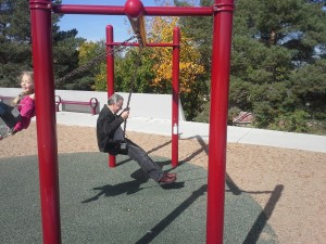 Grandpa Jim...just a big kid, swinging with his Granddaughter!
